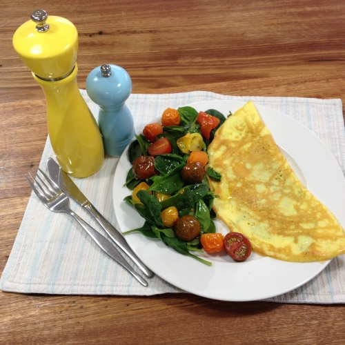 Basil and Parmesan folded Omelette with Spinach and Roasted Tomatoes